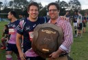 Green and Gold's Reg Roberts presents Melbourne Rising captain Scott Fuglistaller with the Horan-Little Shield