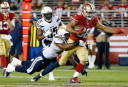 Jarryd Hayne of the San Francisco 49ers tackled by the San Diego Chargers