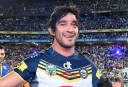 Johnathan Thurston celebrates after winning the NRL Grand Final <br /> <a href='http://www.theroar.com.au/2015/10/04/player-ratings-from-the-nrl-grand-final/'>Player Ratings from the NRL Grand Final</a>