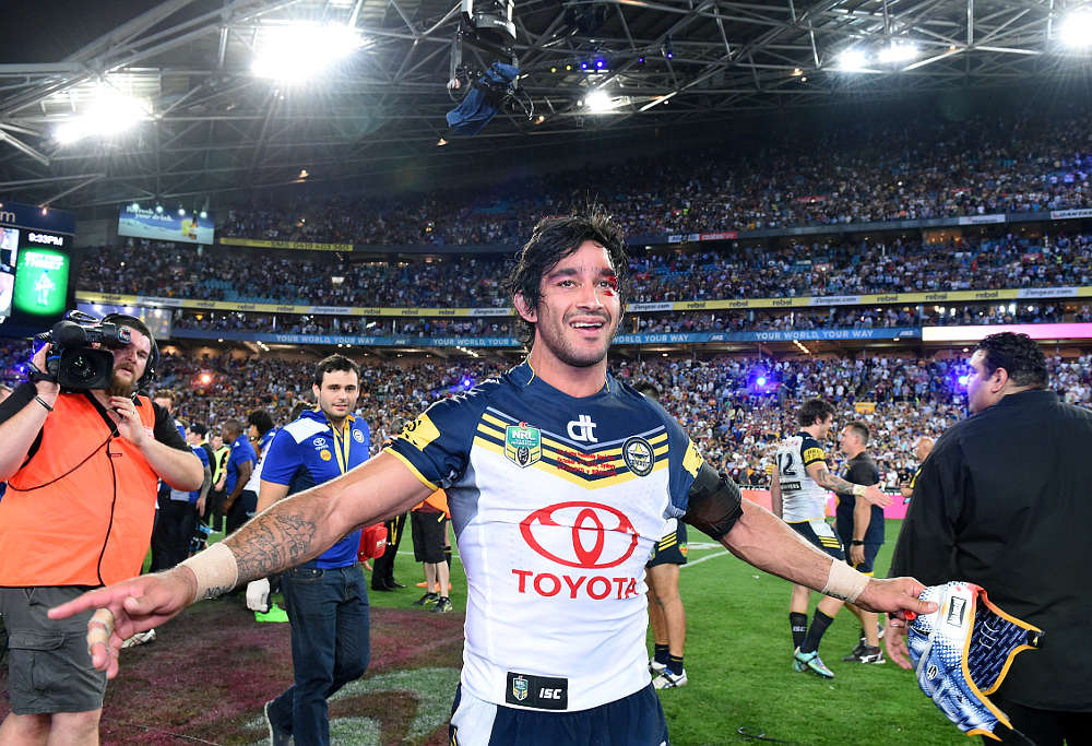 Johnathan Thurston celebrates after winning the NRL Grand Final