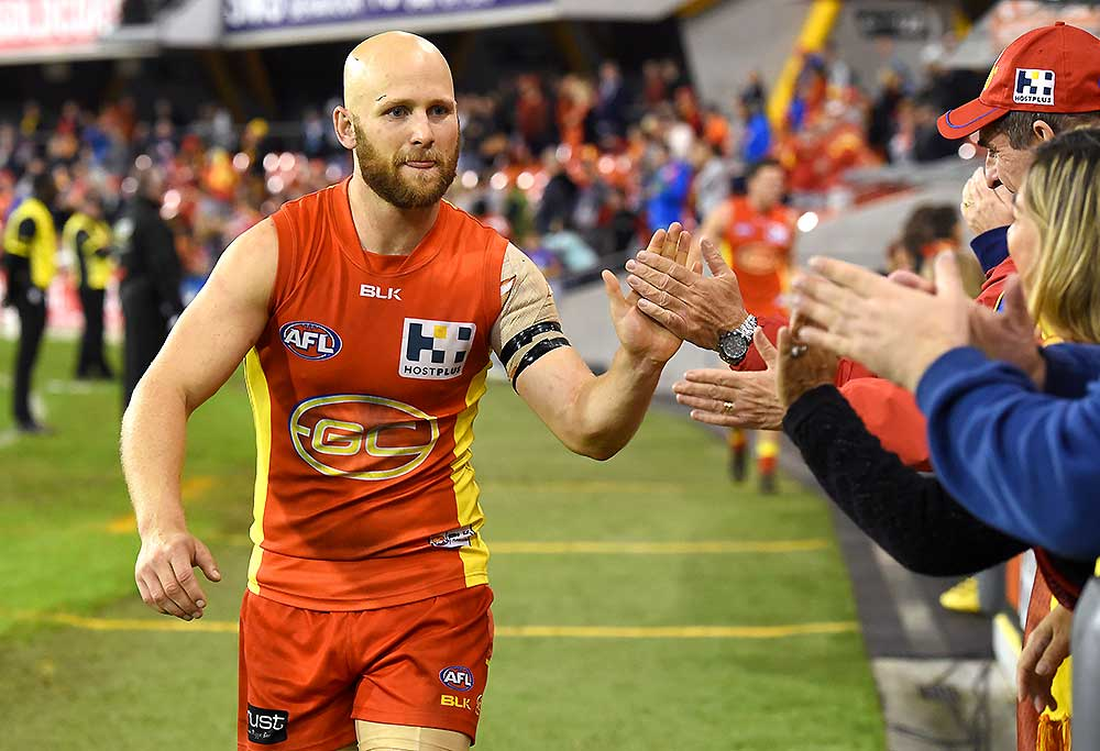 Suns player Gary Ablett reacts with fans