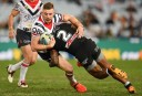 Tigers winger tackles Jackson Hastings of the Roosters <br /> <a href='http://www.theroar.com.au/2015/12/30/sydney-roosters-2016-nrl-season-preview/'>Sydney Roosters 2016 NRL season preview</a>