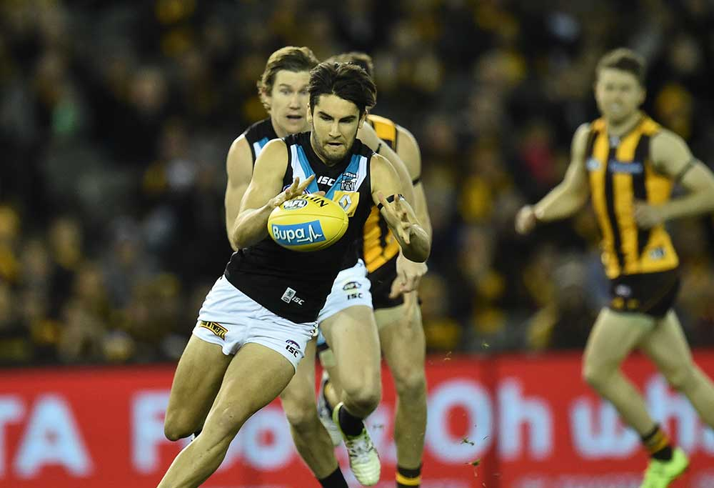 Port Adelaide Power player Chad Wingard (left) possess the ball against the Hawthorn Hawks