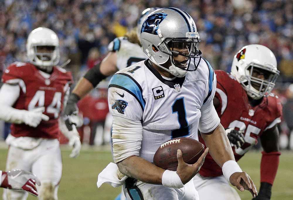 Cam Newton runs the ball.