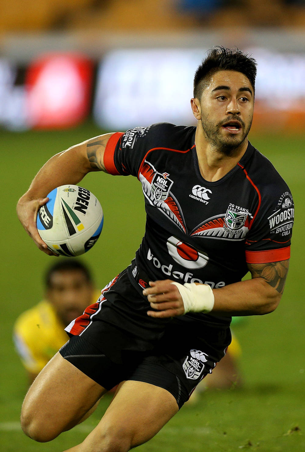 Shaun Johnson running with football
