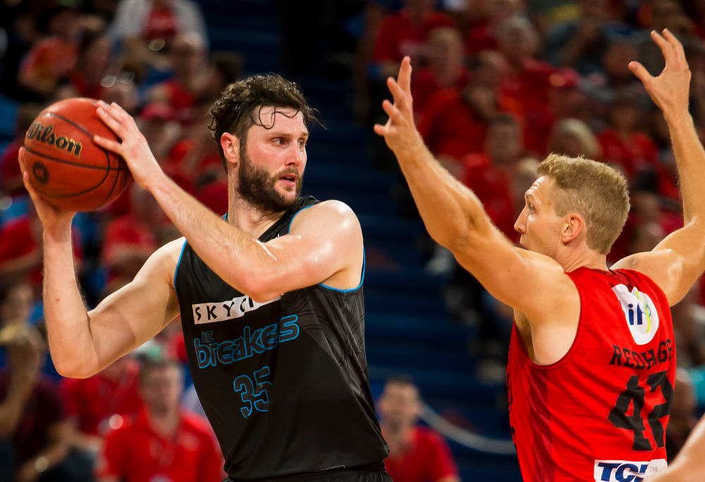 Alex Pledger and Shawn Redhage compete for the basketball