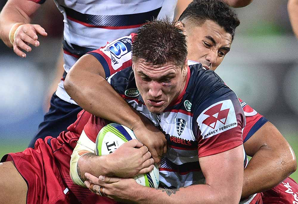 Sean McMahon of the Melbourne Rebels is tackled