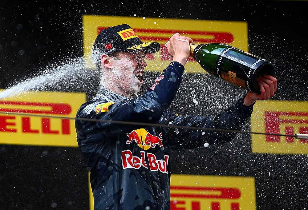 Daniil Kvyat gets sprayed with champagne