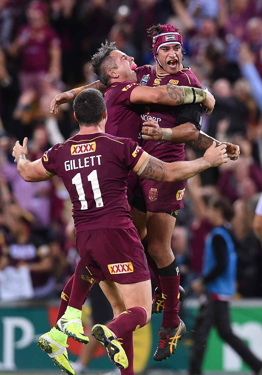 Johnathan Thurston of the Queensland Maroons (right) and teammate Corey Parker celebrate winning
