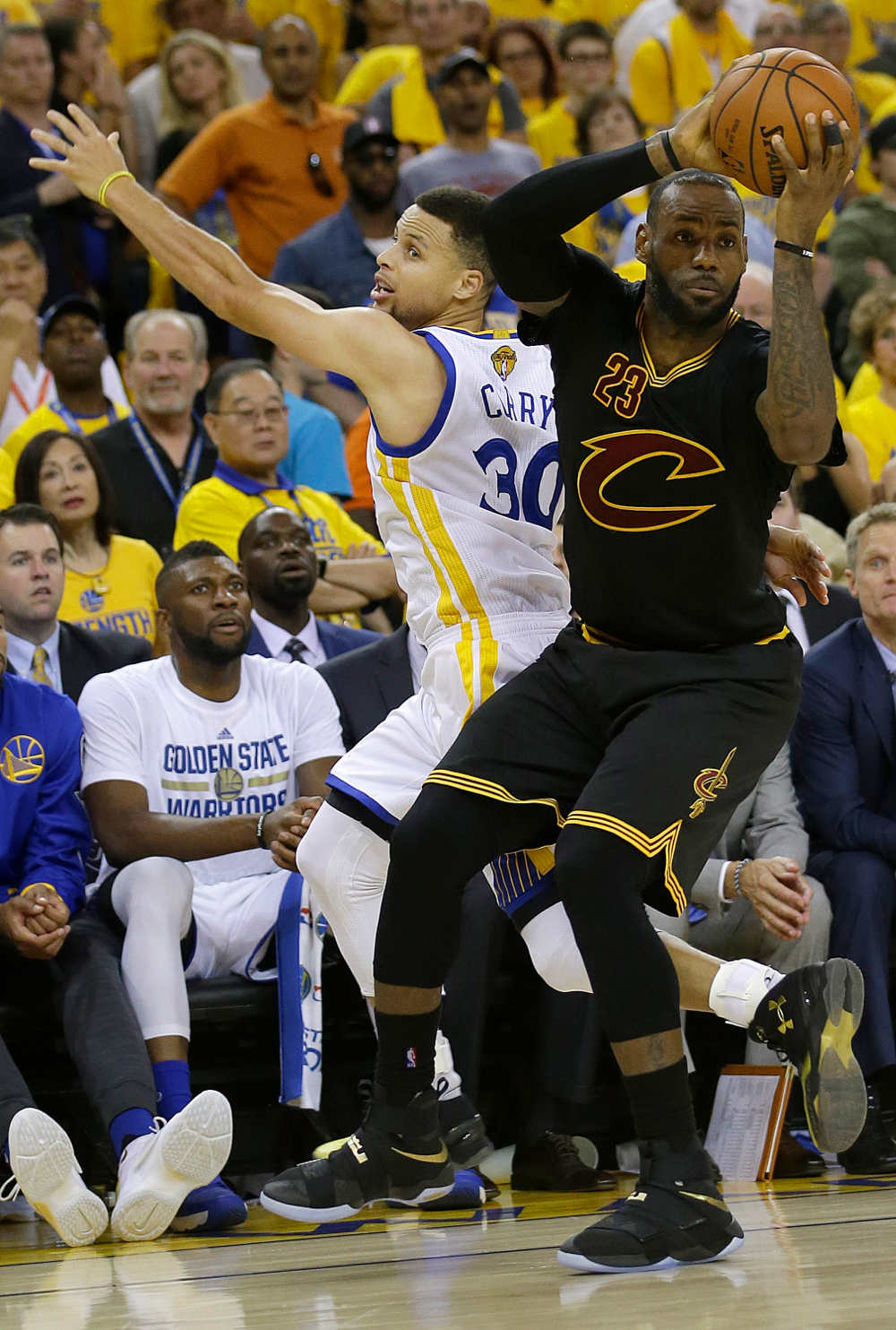 Cleveland Cavaliers forward LeBron James is defended by Golden State Warriors guard Stephen Curry