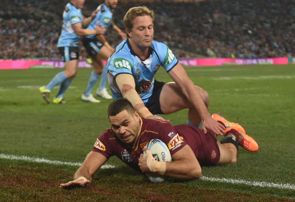Greg Inglis of the Maroons scores a try as Matt Moylan tackles