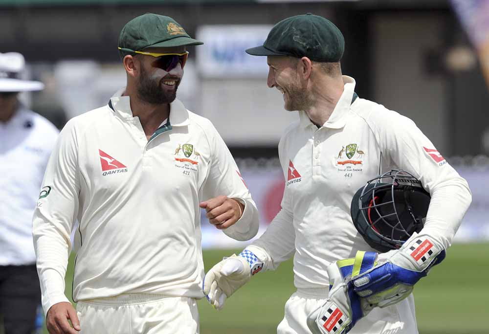 Nathan Lyon and Peter Nevill laughing