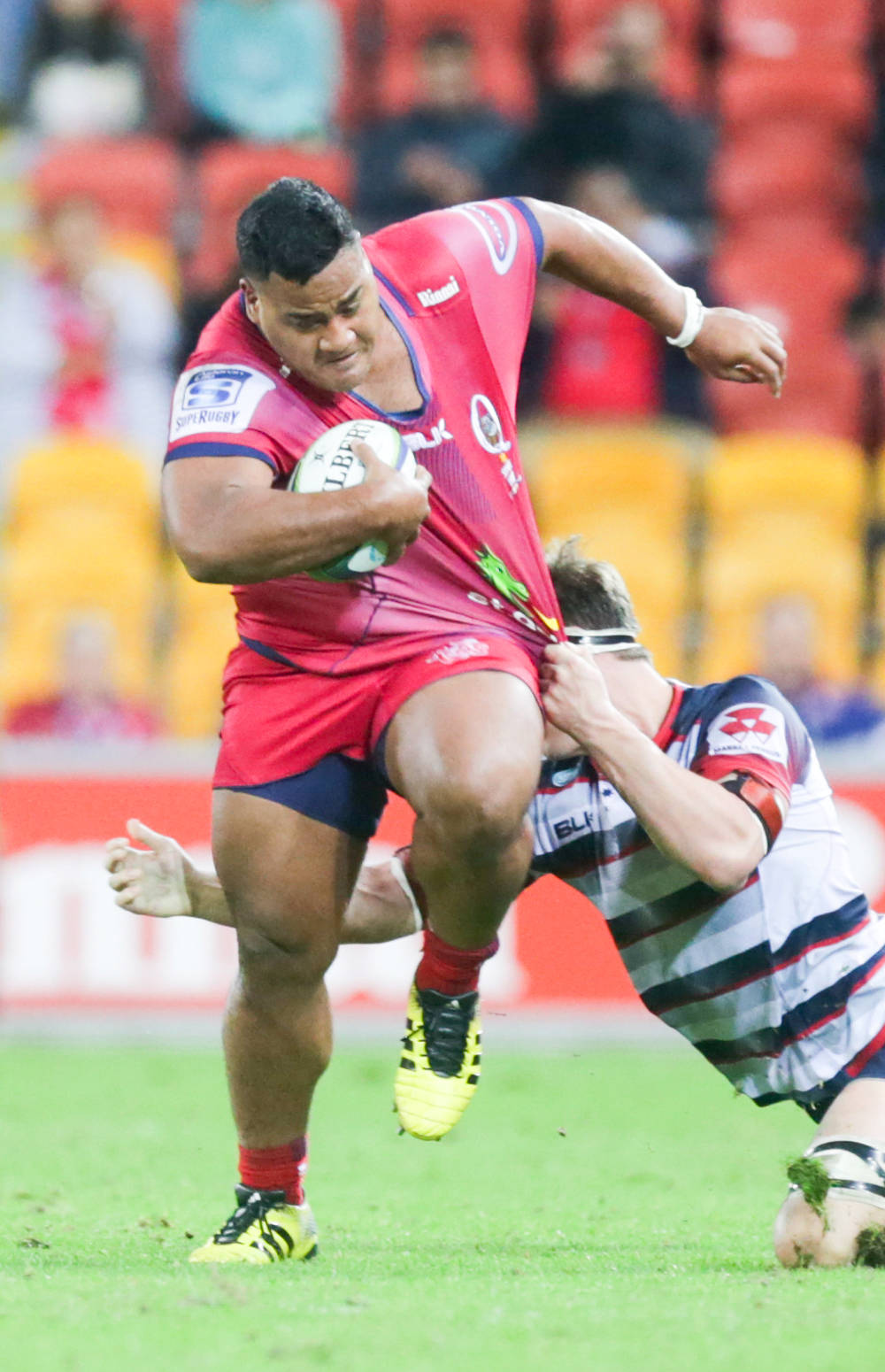 Taniela Tupuo breaking a tackle against the Rebels