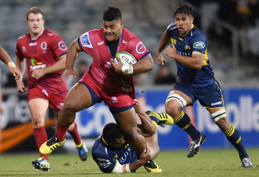 Scott Sio of the Brumbies tackles Taniela Tupou of the Reds during the round 15 Super Rugby match between the ACT Brumbies and the Queensland Reds at GIO Stadium in Canberra, Friday, July 1, 2016. (AAP Image/Dean Lewins)