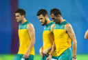 Australian players react after losing the group A match between Australia and Spain