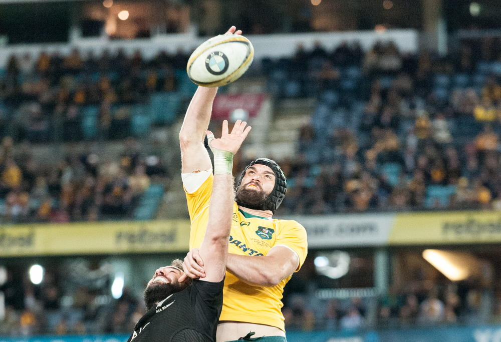 Wallabies' replacement lock Scott Fardy leaps above Sam Whitelock