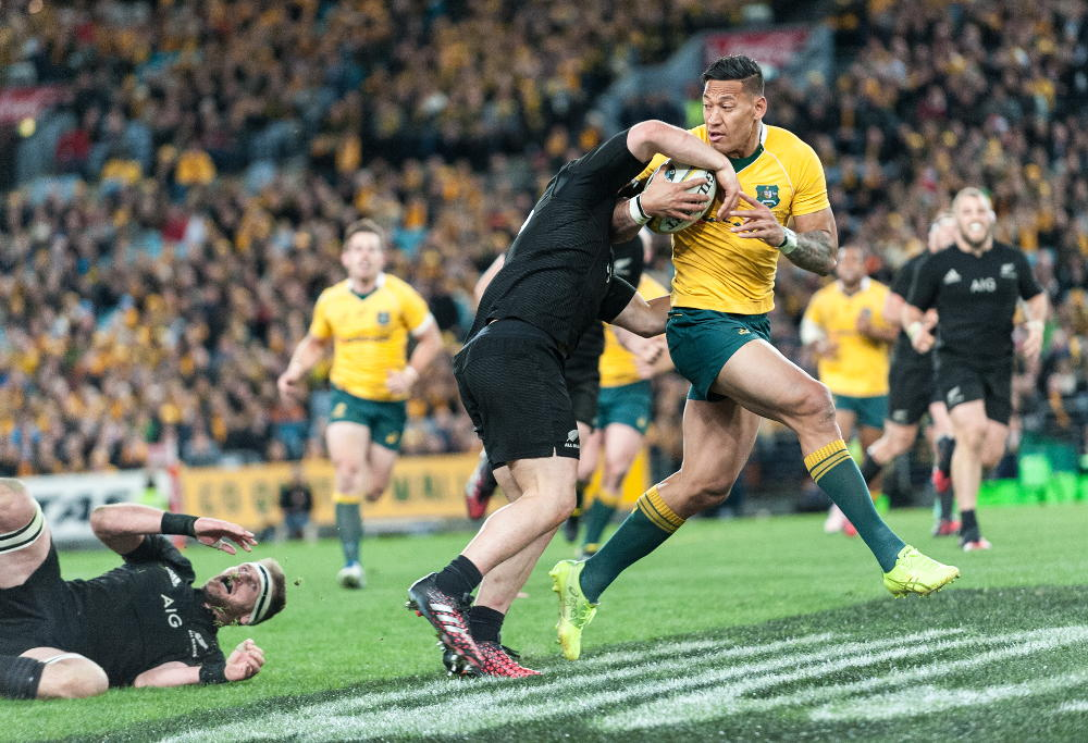 Israel Folau tries to break the tackle of Dane Coles