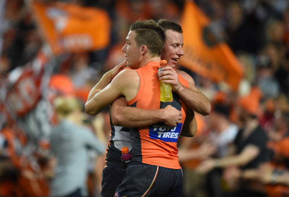 Steve Johnson and Toby Greene embrace in the AFL Finals 2016