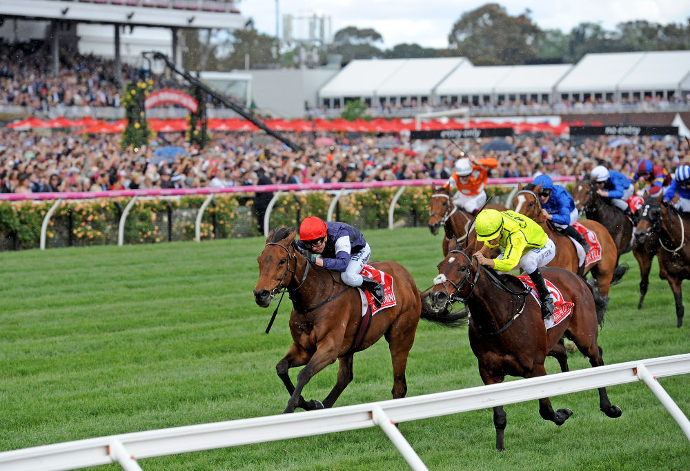 Almandin ridden by jockey Kerrin McEvoy leads the field to win the $6million Melbourne Cup, followed by Heartbreak City, at Flemington Racecourse in Melbourne, Tuesday. Nov. 1, 2016