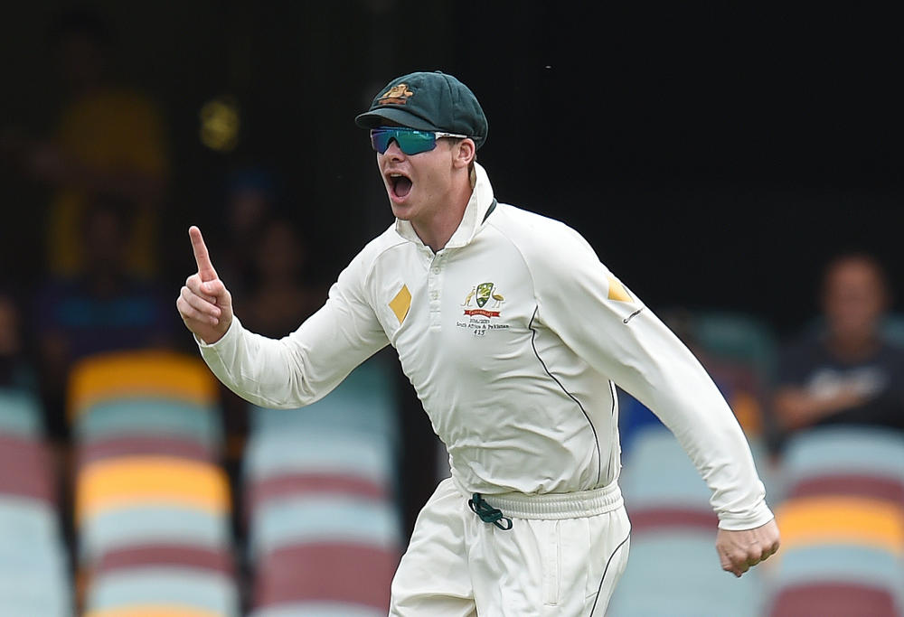 Steve Smith celebrates a run out