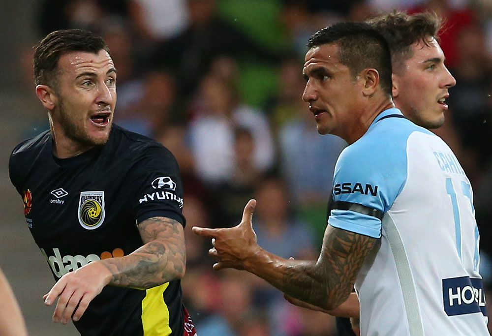 Roy O'Donovan of the Mariners (left) is confronted by Tim Cahill of City