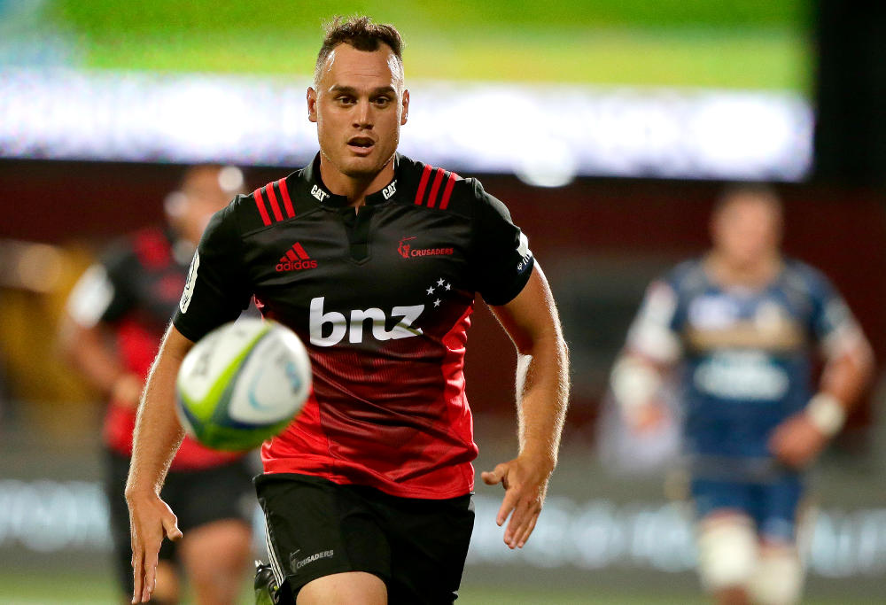 Crusaders Israel Dagg runs after the ball