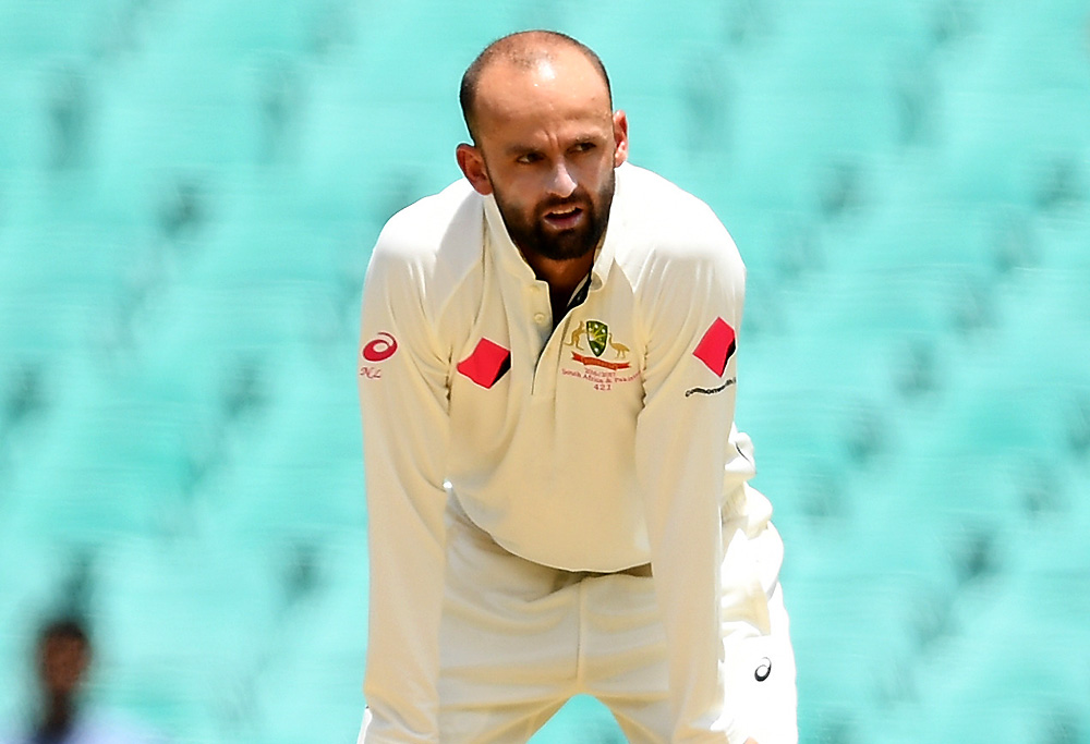 Nathan Lyon of Australia looks on