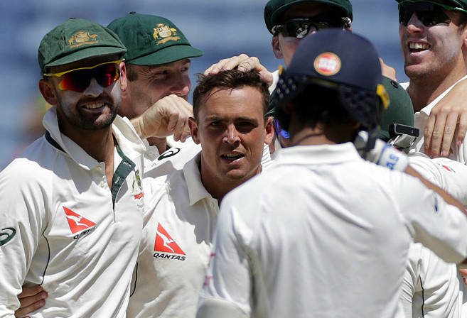 Australia's Steve O'Keefe celebrates the dismissal of India's Ajinkya Rahane