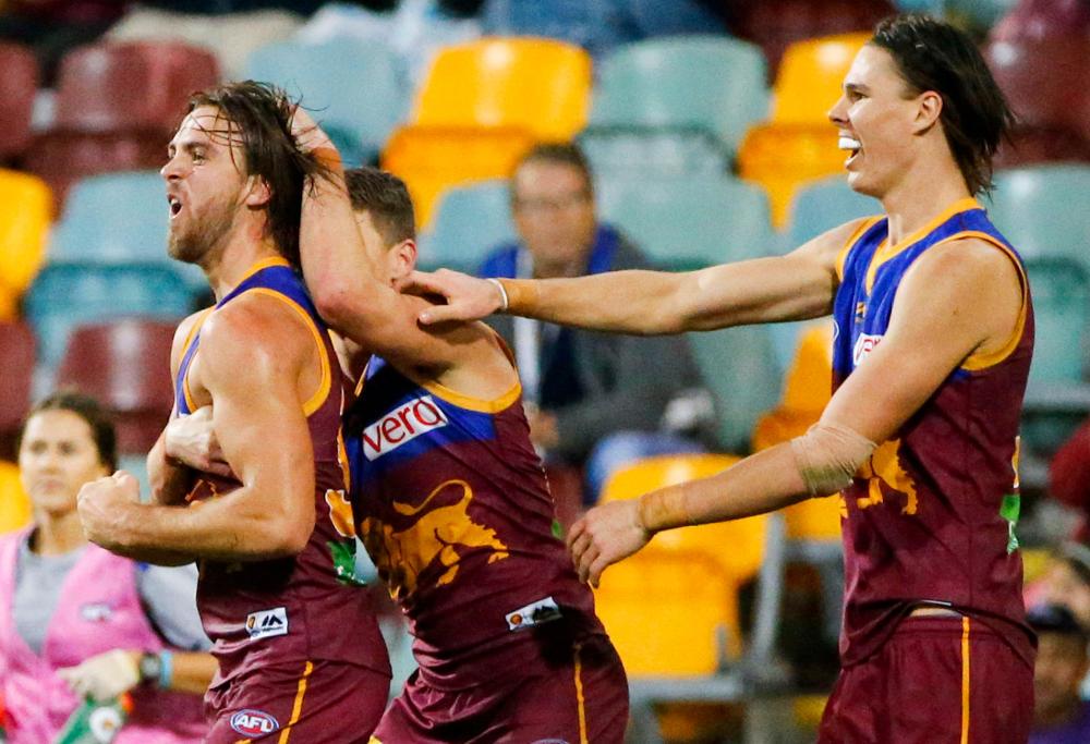 Brisbane Lions celebrate a goal