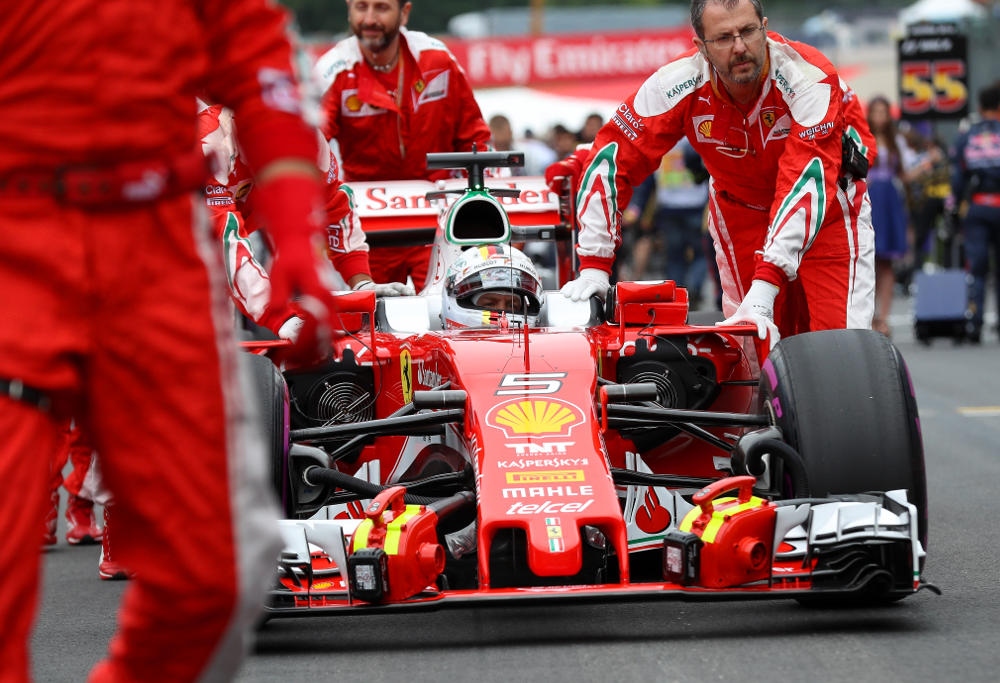 Sebastian Vettel's Formula One visits the Ferrari pit lane at Austria's Grand Prix.