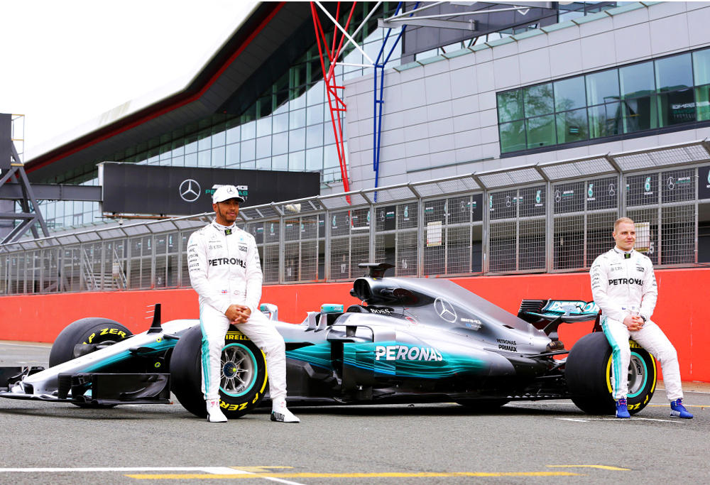 Formula One drivers Lewis Hamilton and Valtteri Bottas unveil Mercedes' new car - the Silver Arrow.