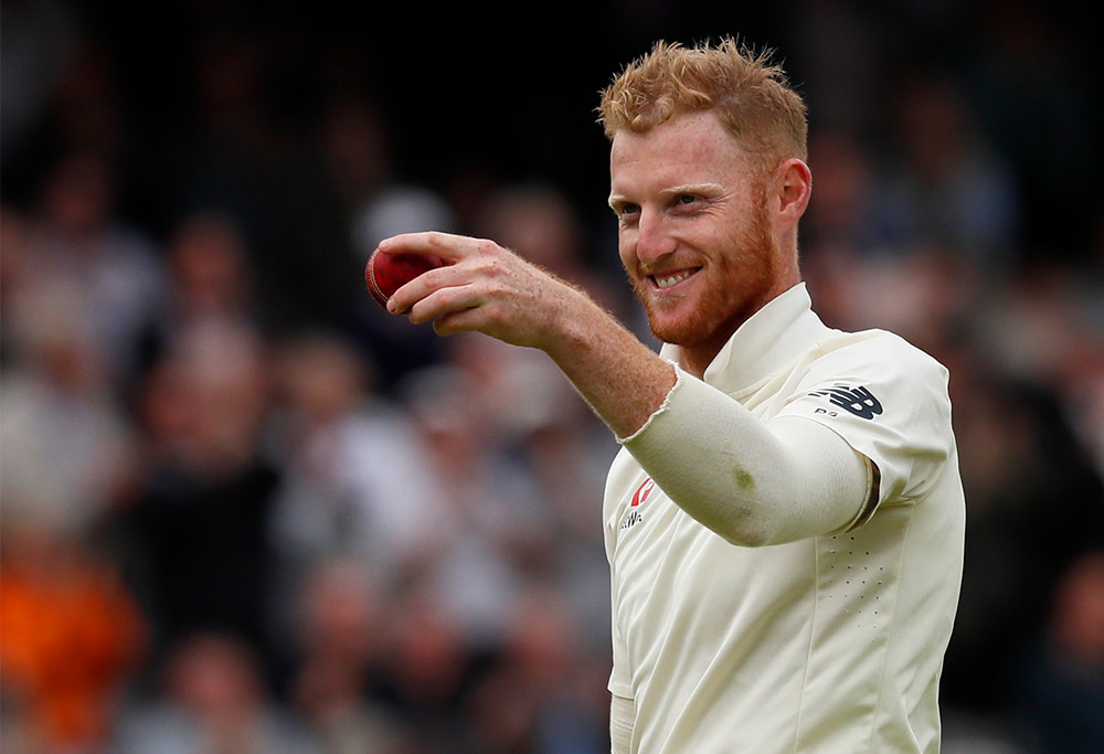 Ben Stokes holds up the ball and grins after taking his sixth wicket