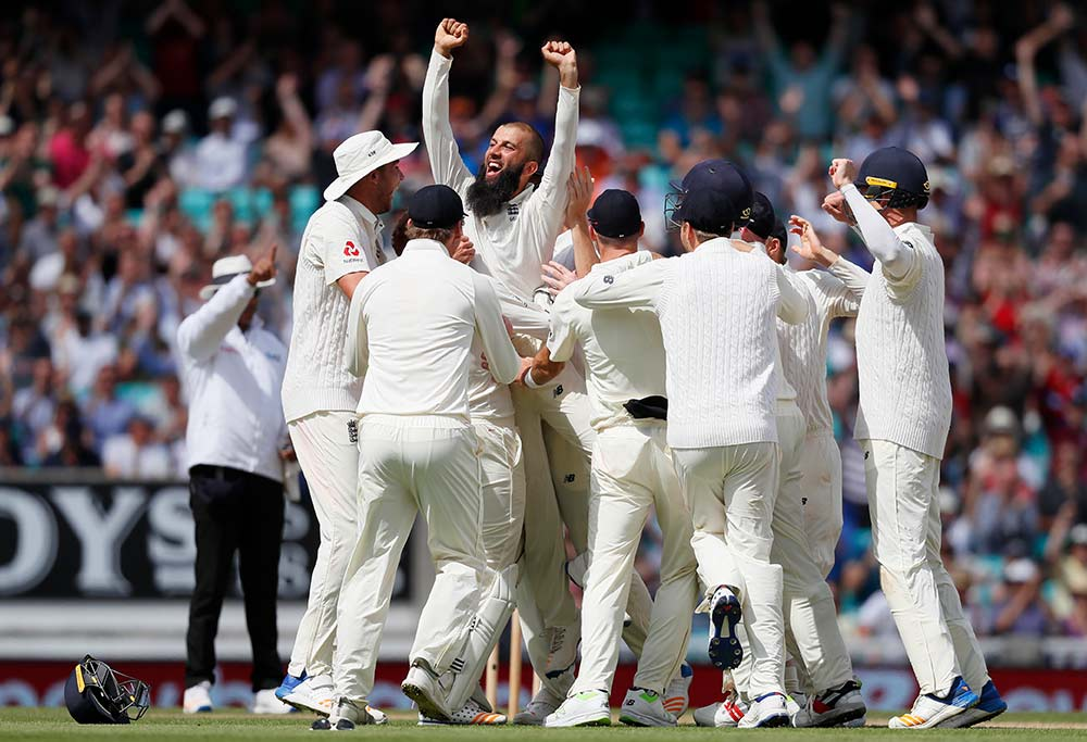 England's Moeen Ali lifted up by his team mates