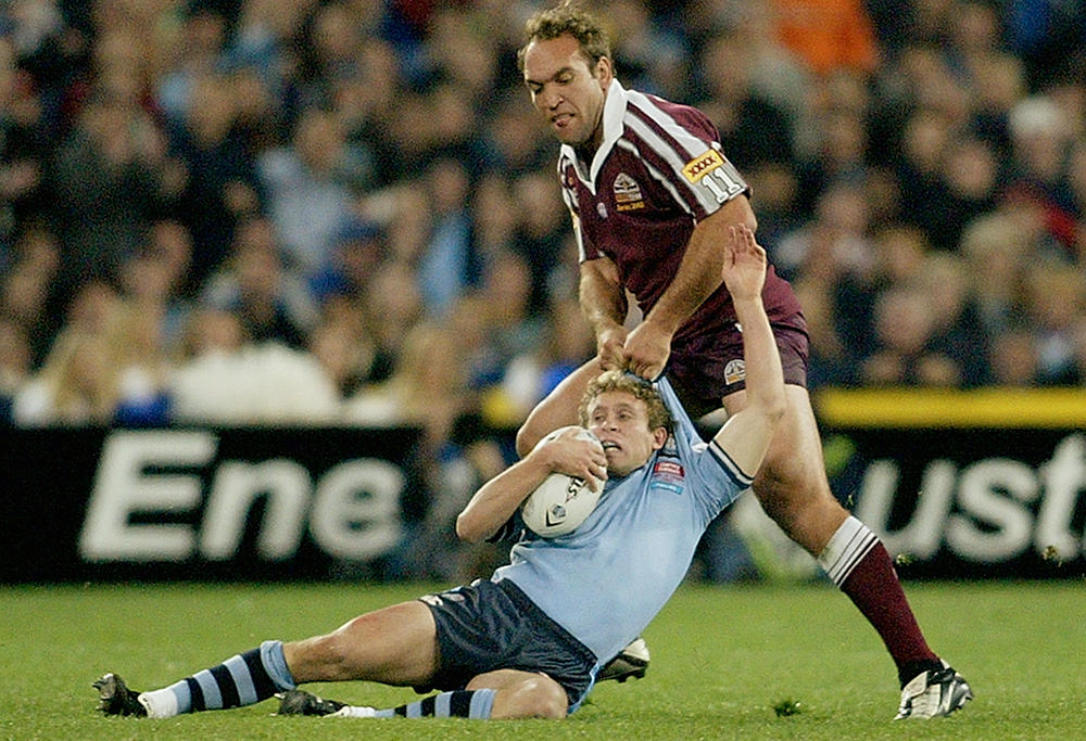 Brett Hodgson is tackled by Gorden Tallis
