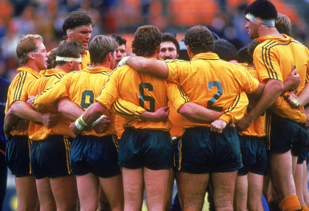 The Wallabies stand in a group huddle before the start of the Rugby World Cup match between the Australian Wallabies and Wales in Sydney, Australia. Australia won the match 33 - 15.