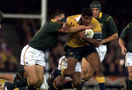 Jim Williams for Australia attempts to break a tackle