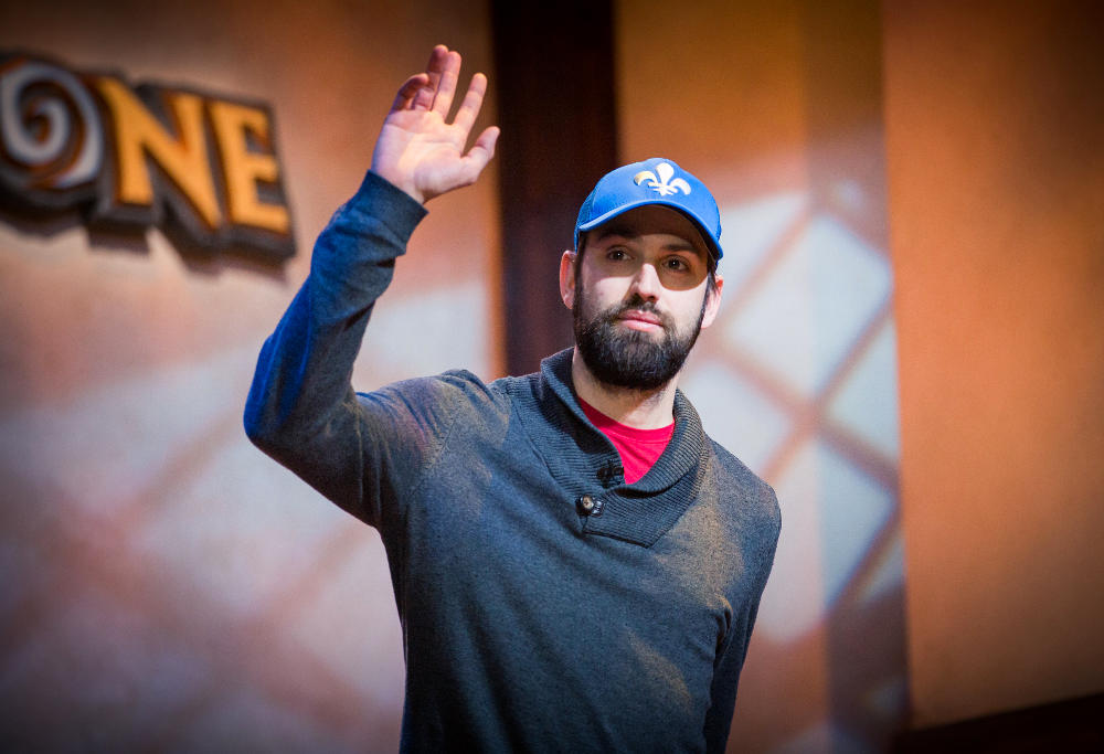 "Julien ""DocPwn"" Bachand, of Canada, salutes the crowd at the Hearthstone Championship Tour in Amsterdam."